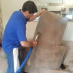 Furniture cleaning Doncaster me claning a sofa in Doncaster